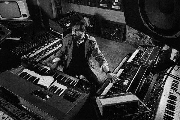 Vangelis in the mid eighties, between his synth setup at the Nemo studio